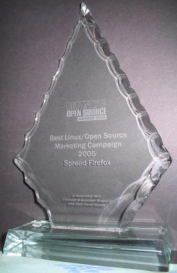 A diamond-shaped glass trophy engraved with 'Best Linux/Open Source Marketing Project'